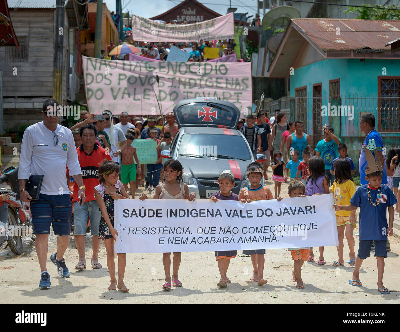 Indigenous people march through the streets of Atalaia do Norte in Brazil's Amazon region, protesting a government plan to municipalize health care. - Stock Image
