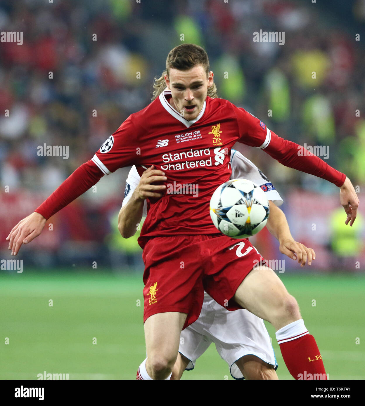 Andy Robertson of Liverpool fights for a ball with Luka Modric of Real Madrid during their UEFA Champions League Final 2018 - Stock Image