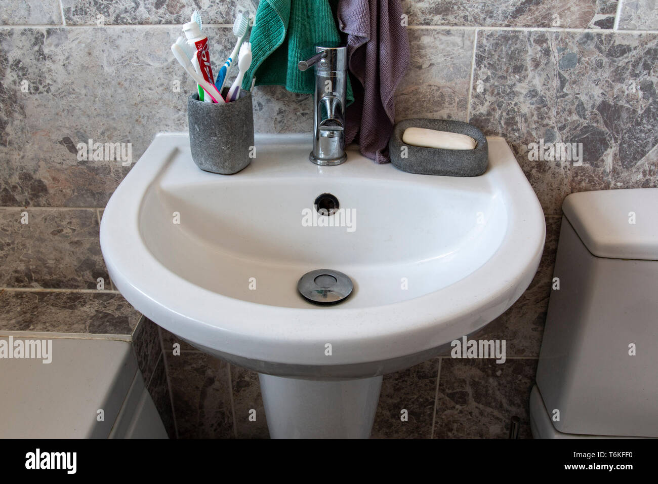bathroom sink after it has been cleaned - Stock Image