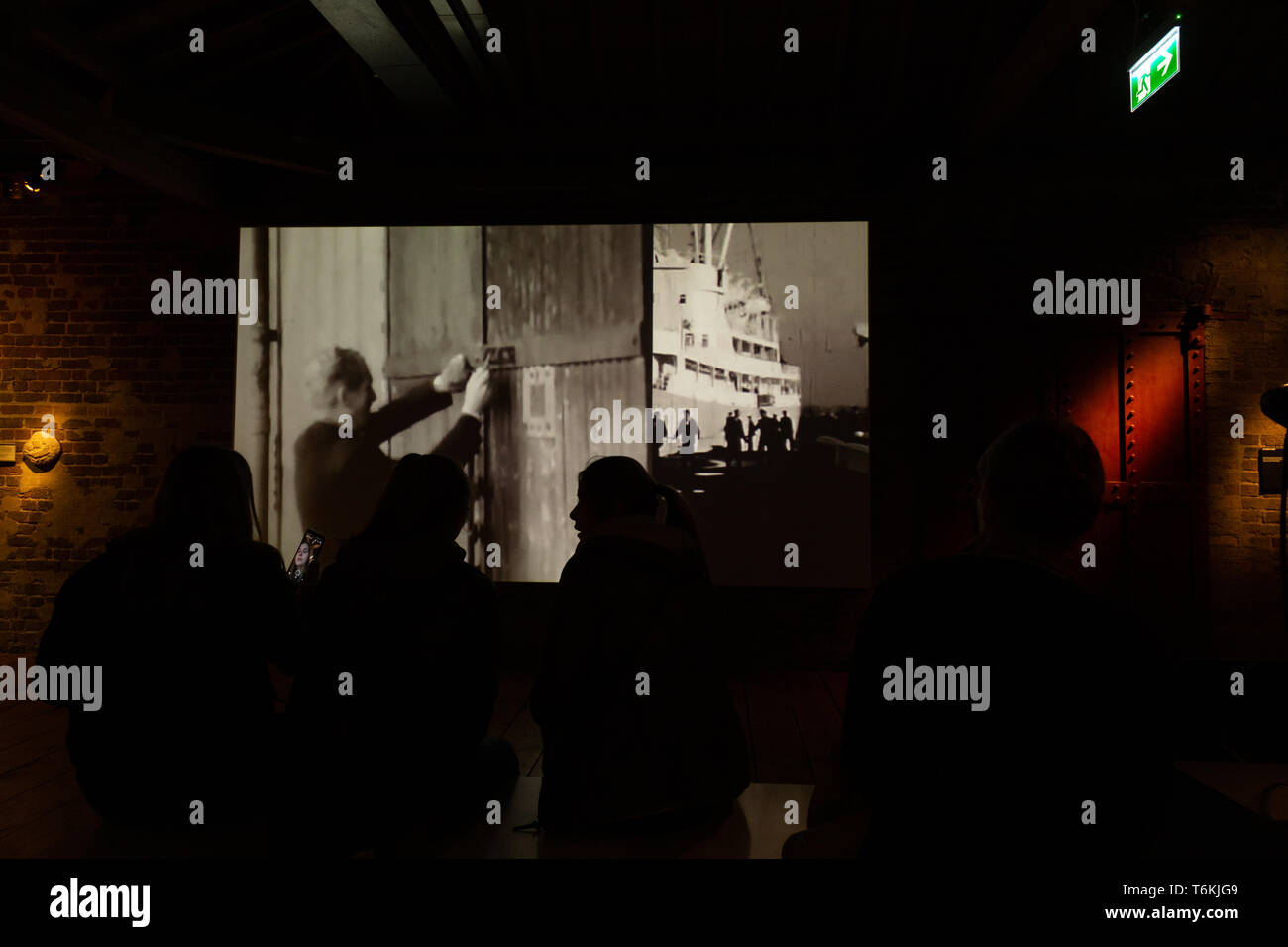 Film projection of the maritime history at the Docklands museum of London. - Stock Image