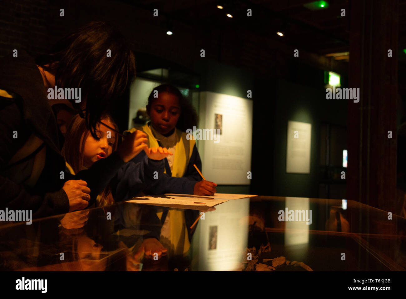 Children during the visit at the Roman Dead exhibition at the Museum of London Docklands. - Stock Image