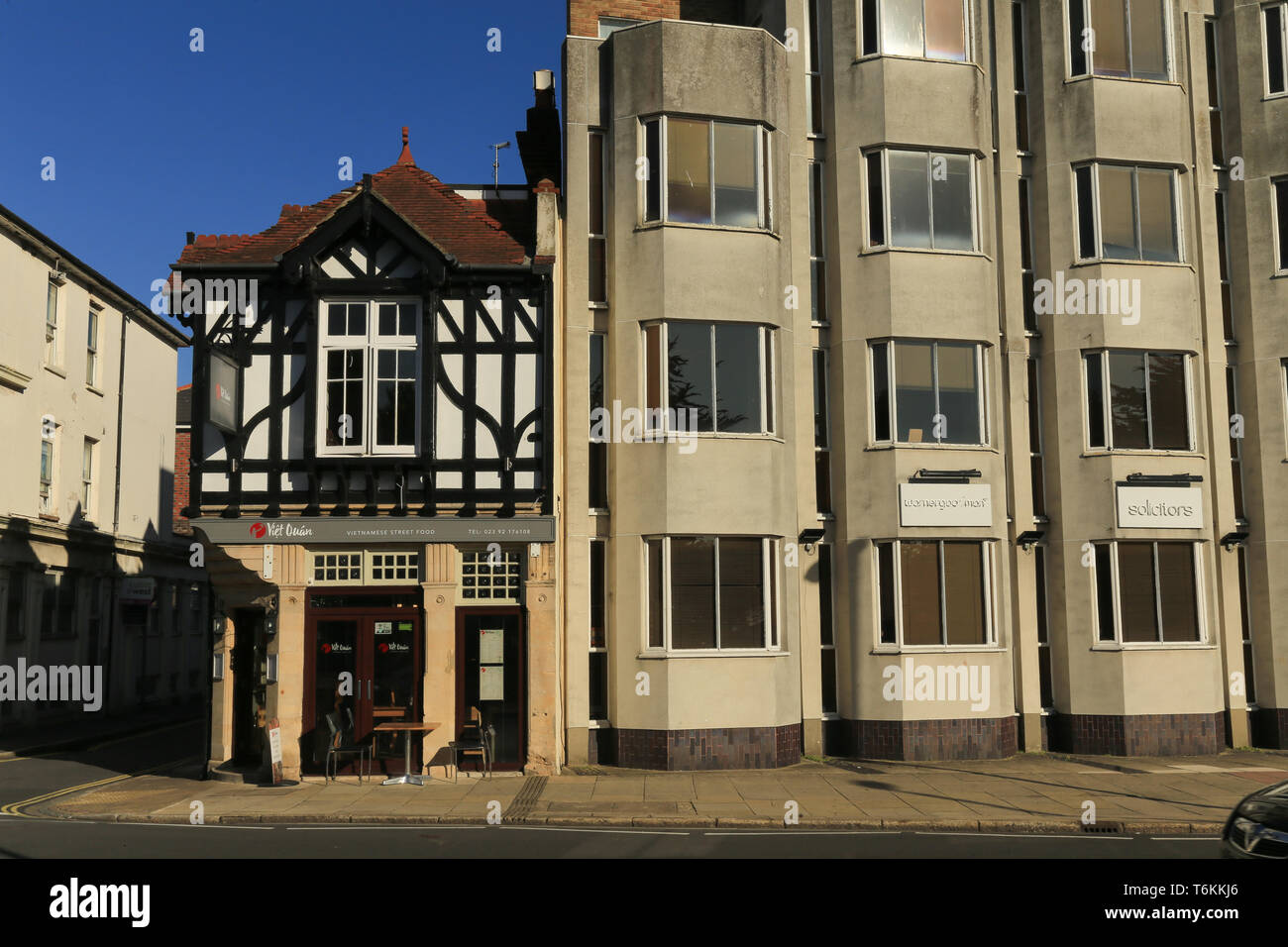 Contrast between an old half timber house attached to a modern home. Portsmouth. - Stock Image