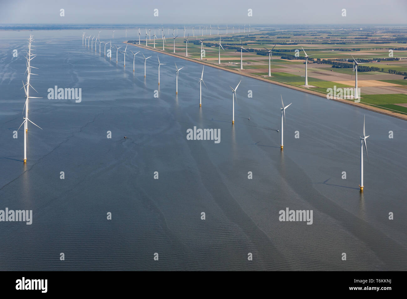 Aerial view Dutch sea with offshore wind turbines along coast Stock Photo