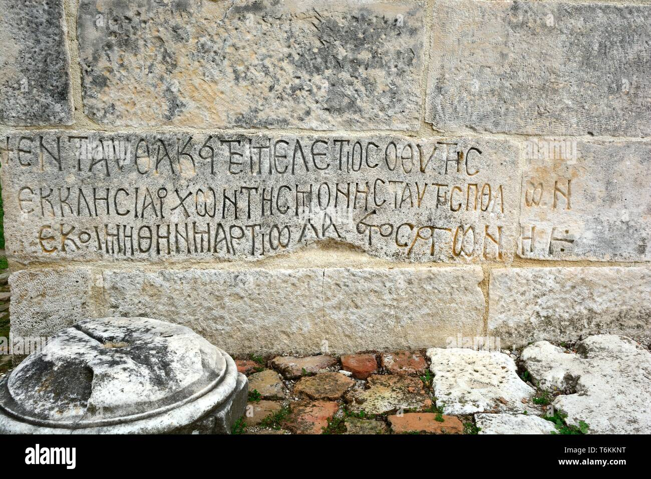 Ancient Greek script on a wall of the ruined Greek city of Apollonia Albania - Stock Image