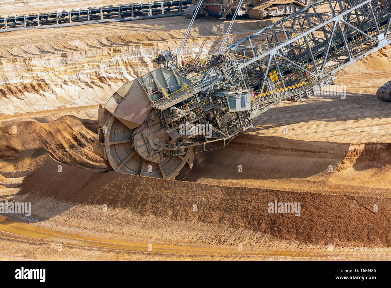 Brown coal open pit landscape with digging excavators in Germany - Stock Image