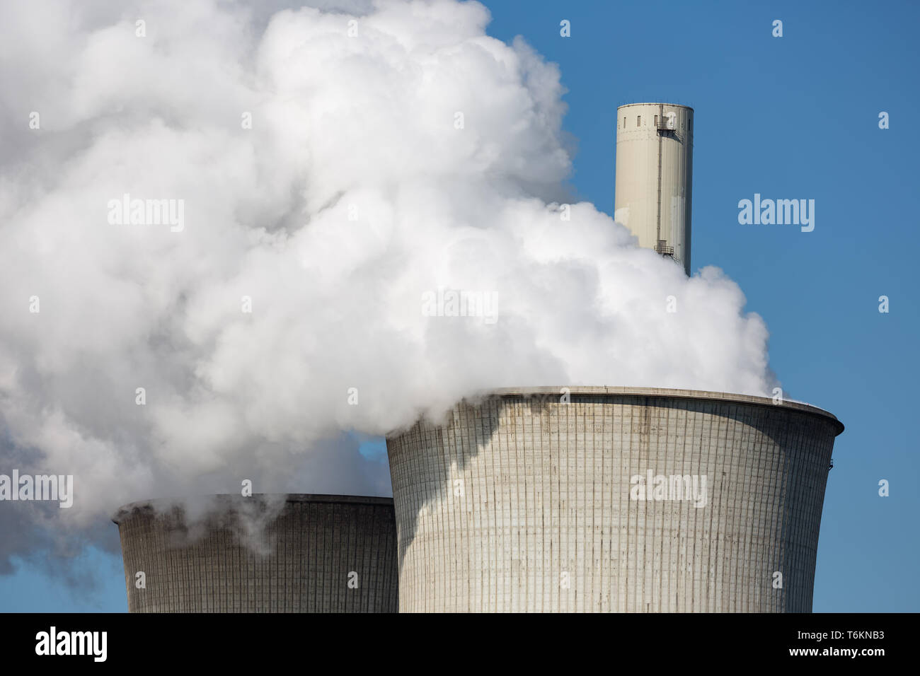 Cooling towers and smokestacks coal fired power plant in Germany Stock Photo