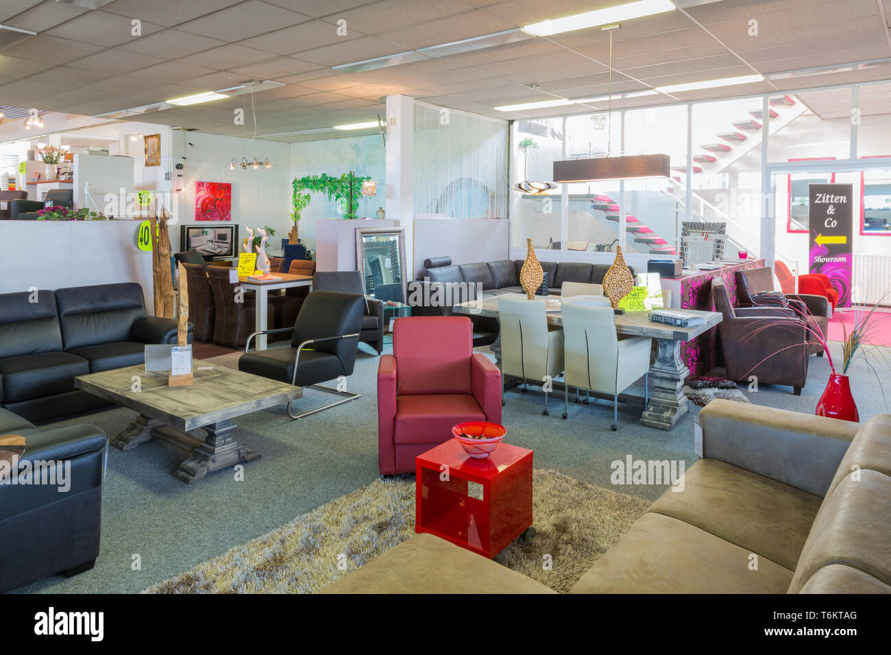 furniture showroom with tables and chairs stock image
