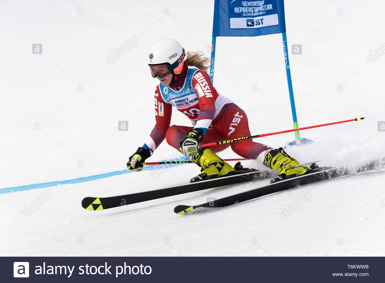 KAMCHATKA PENINSULA, RUSSIA - APR 2, 2019: Mountain skier Rinata Abdulkayumova (Kamchatka) skiing down mount. International Ski Federation, Championsh - Stock Image