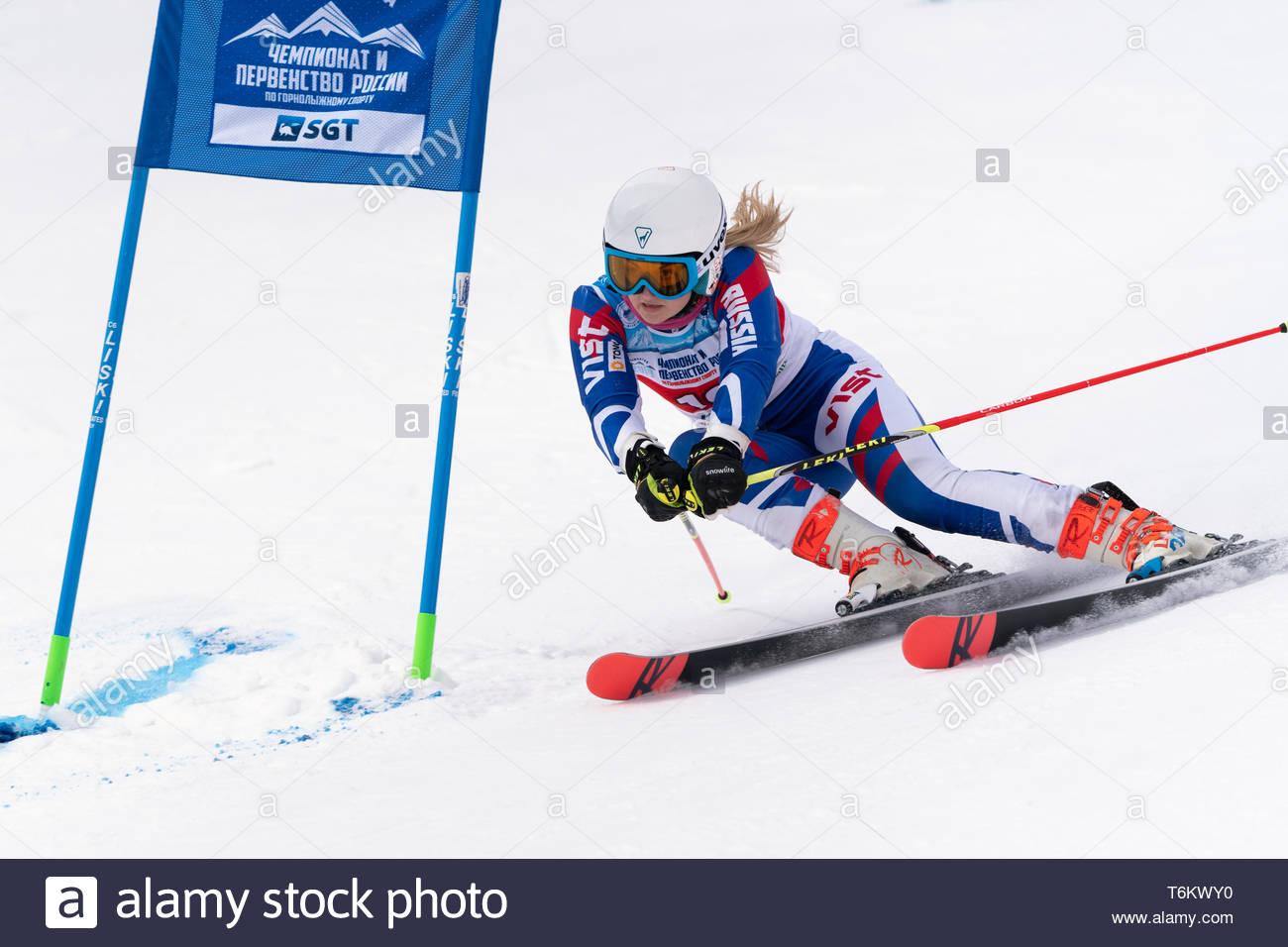 KAMCHATKA PENINSULA, RUSSIA - APRIL 2, 2019: Mountain skier Yaroslava Popova (Krasnoyarsk) skiing down mount. International Ski Federation, Championsh - Stock Image