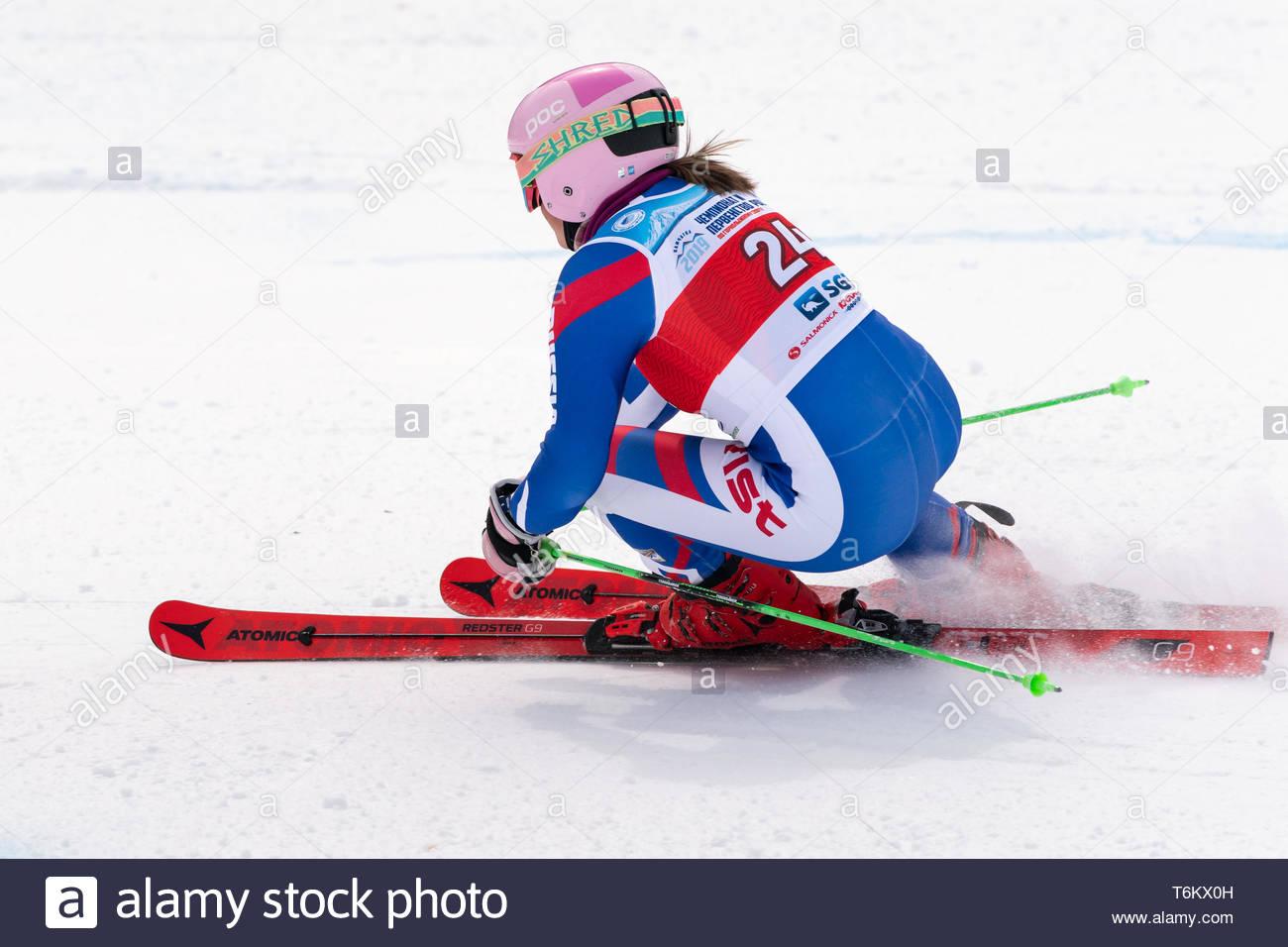 KAMCHATKA PENINSULA, RUSSIA - APR 2, 2019: Mountain skier Vitalina Girina (Moscow Region) skiing down mount. Russian Women's Alpine Skiing Cup, Intern - Stock Image