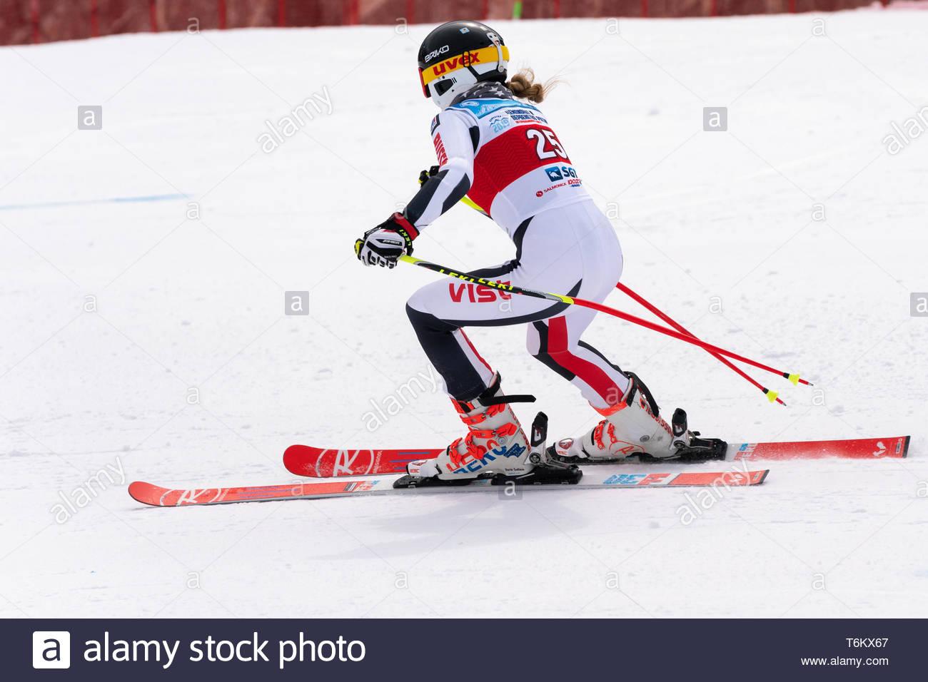 KAMCHATKA PENINSULA, RUSSIA - APRIL 2, 2019: Mountain skier Sautieva Daria (Moscow) skiing down mount slope. Russian Women's Alpine Skiing Cup, Intern - Stock Image