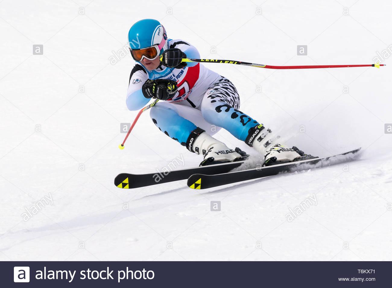 KAMCHATKA PENINSULA, RUSSIA - APR 2, 2019: Mountain skier Veronika Gavrish (Murmansk) skiing down mount slope. International Ski Federation Championsh - Stock Image