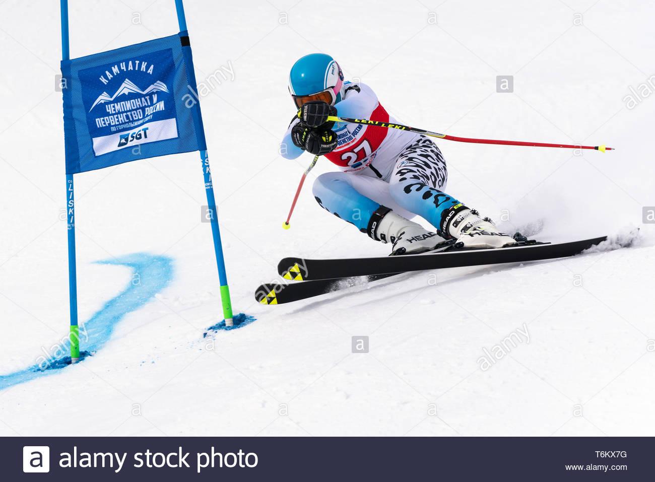 KAMCHATKA PENINSULA, RUSSIA - APR 2, 2019: Russian Women's Alpine Skiing Cup, International Ski Federation Championship giant slalom. Mountain skier G - Stock Image