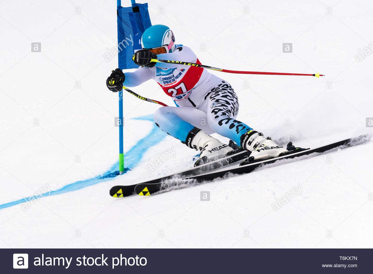 KAMCHATKA, RUSSIA - APR 2, 2019: International Ski Federation Championship, Russian Women's Alpine Skiing Cup giant slalom. Mountain skier Veronika Ga - Stock Image