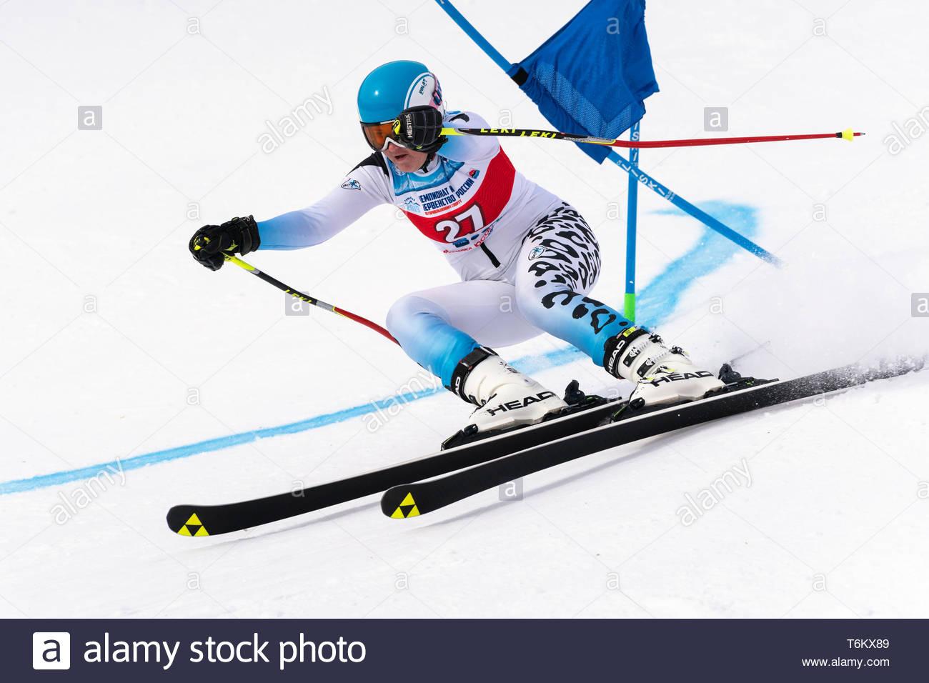 KAMCHATKA PENINSULA, RUSSIA - APR 2, 2019: Mountain skier Veronika Gavrish (Murmansk) skiing down mount slope. Russian Women's Alpine Skiing Cup, Inte - Stock Image
