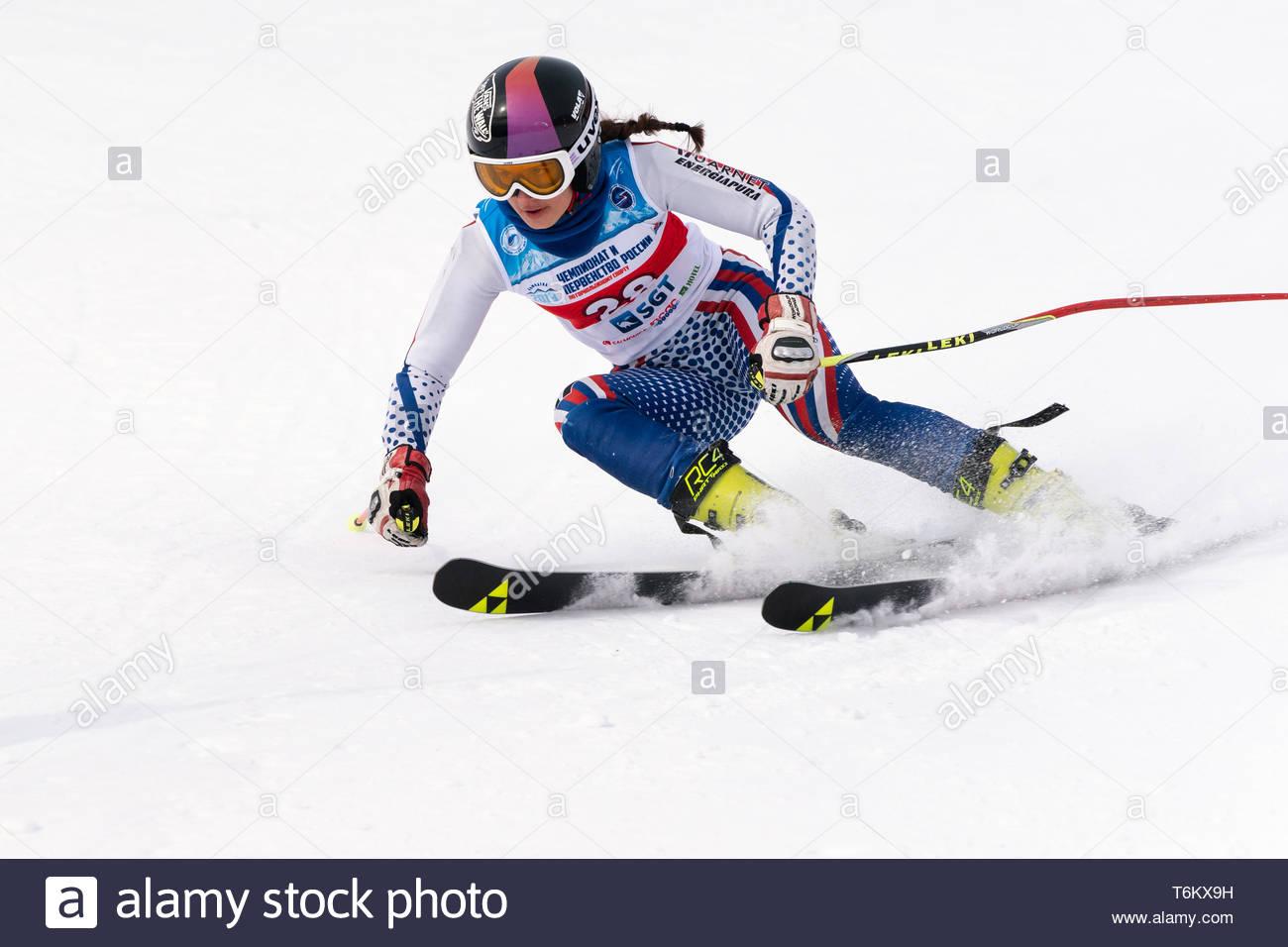 KAMCHATKA PENINSULA, RUSSIA - APRIL 2, 2019: Mountain skier Anna Vakhnina (Krasnoyarsk) skiing down mount. Russian Women's Alpine Skiing Cup, Internat - Stock Image