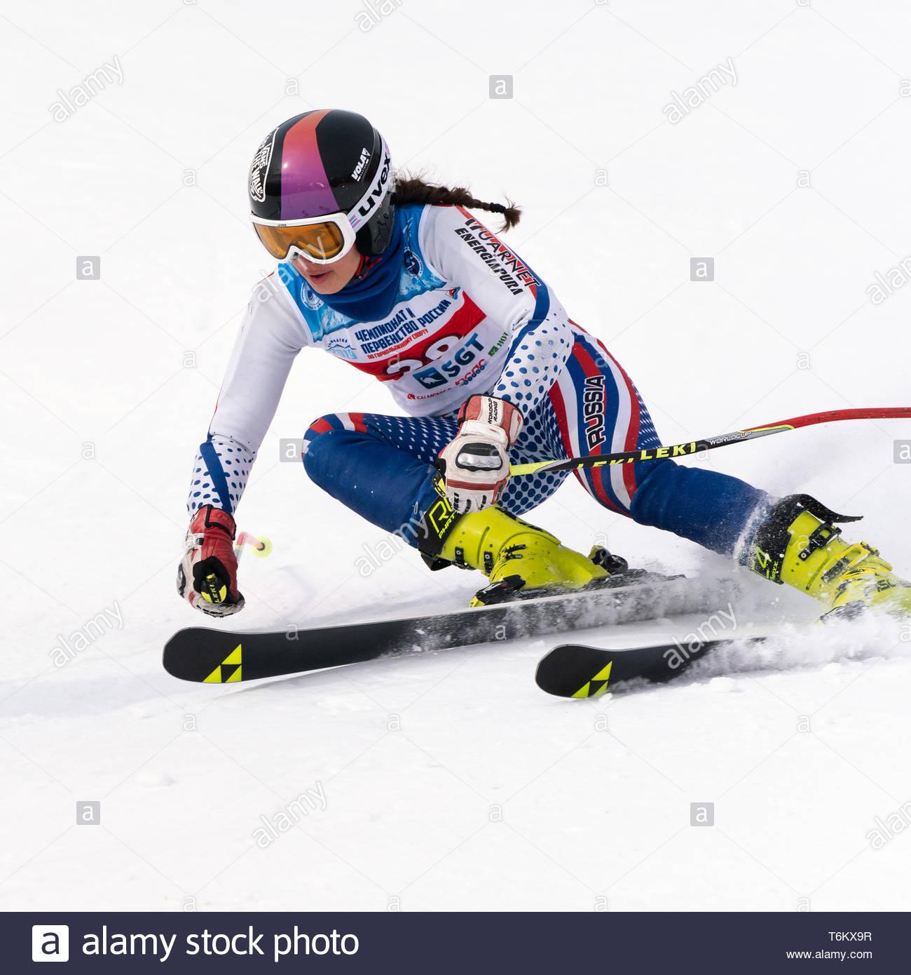 KAMCHATKA PENINSULA, RUSSIA - APRIL 2, 2019: Mountain skier Vakhnina Anna (Krasnoyarsk) skiing down mount. International Ski Federation Championship,  - Stock Image