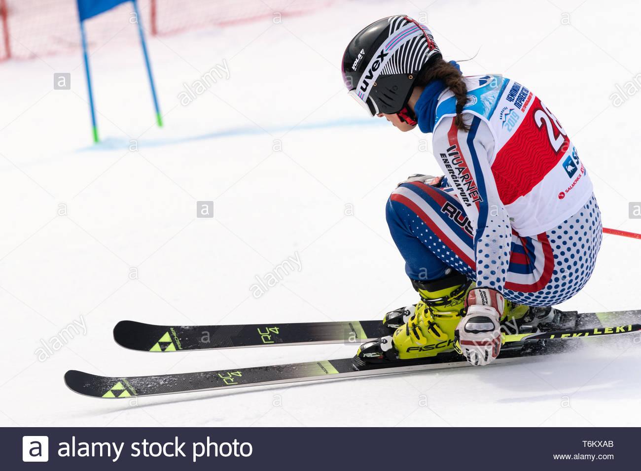 KAMCHATKA PENINSULA, RUSSIA - APRIL 2, 2019: Russian Women's Alpine Skiing Cup, International Ski Federation Championship, giant slalom. Mountain skie - Stock Image