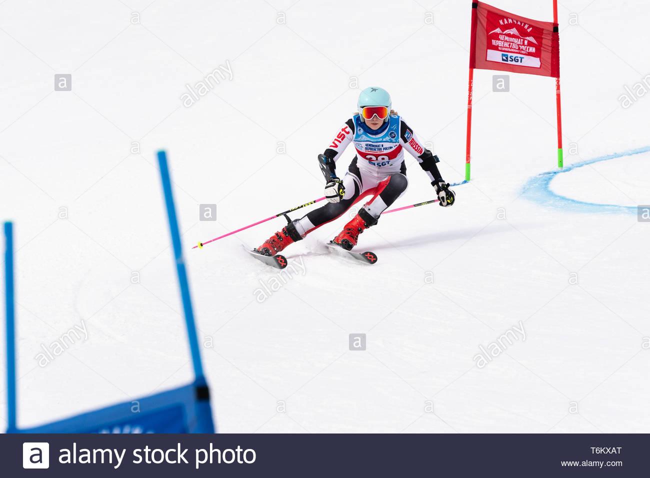 KAMCHATKA PENINSULA, RUSSIA - APRIL 2, 2019: Mountain skier Elesina Elizaveta (Sverdlovsk) skiing down mount. Russian Women's Alpine Skiing Cup, Inter - Stock Image