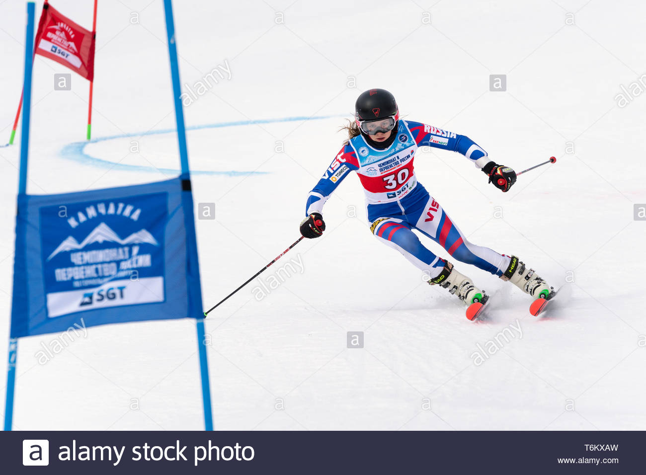 KAMCHATKA PENINSULA, RUSSIA - APRIL 2, 2019: Mountain skier Lendya Ulyana (Kamchatka) skiing down mount slope. Russian Women's Alpine Skiing Cup, Inte - Stock Image