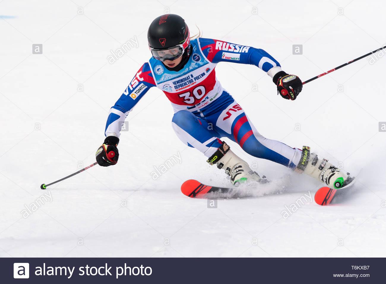 KAMCHATKA, RUSSIA - APR 2, 2019: International Ski Federation Championship, Russian Women's Alpine Skiing Cup, giant slalom. Mountain skier Ulyana Len - Stock Image