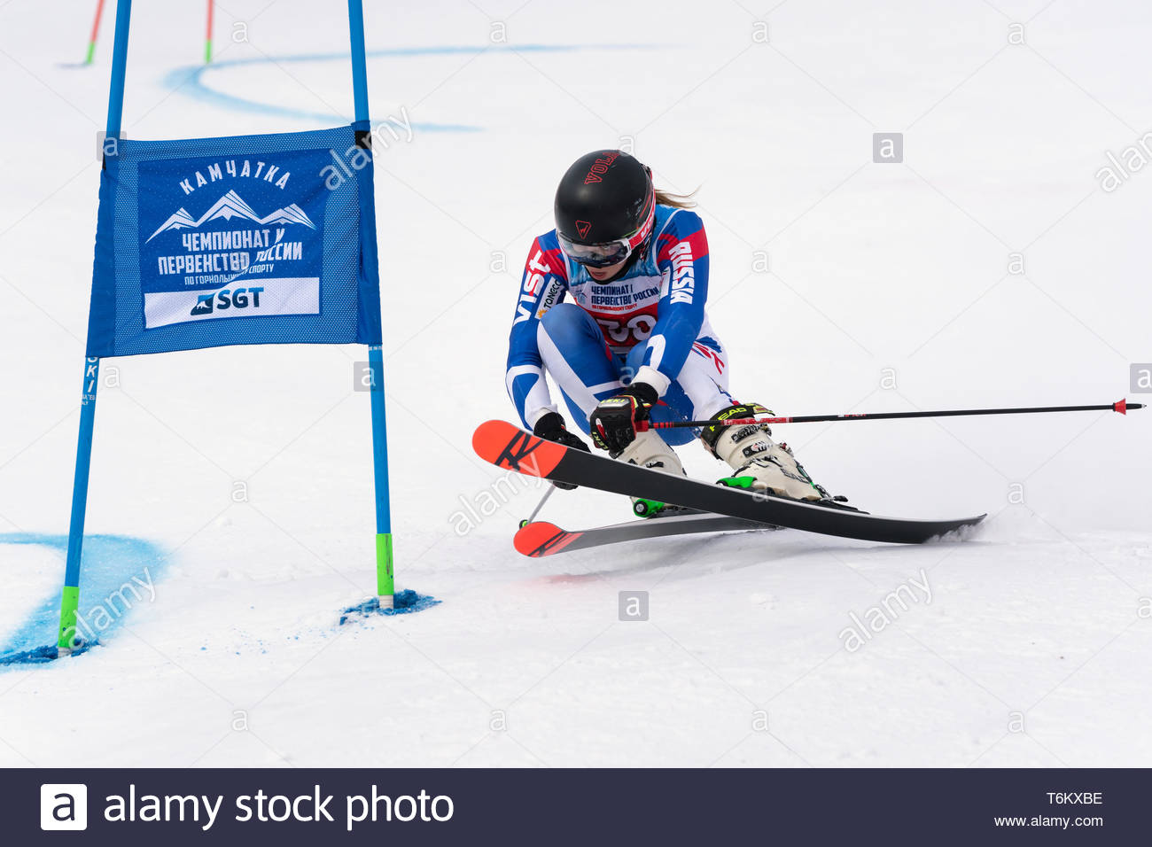 KAMCHATKA PENINSULA, RUSSIA - APRIL 2, 2019: Mountain skier Lendya Ulyana (Kamchatka) skiing down mount slope. International Ski Federation Championsh - Stock Image