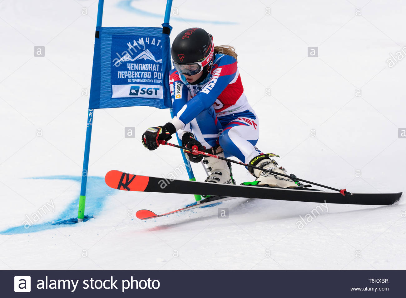 KAMCHATKA PENINSULA, RUSSIA - APR 2, 2019: Russian Women's Alpine Skiing Cup, International Ski Federation Championship, giant slalom. Mountain skier  - Stock Image