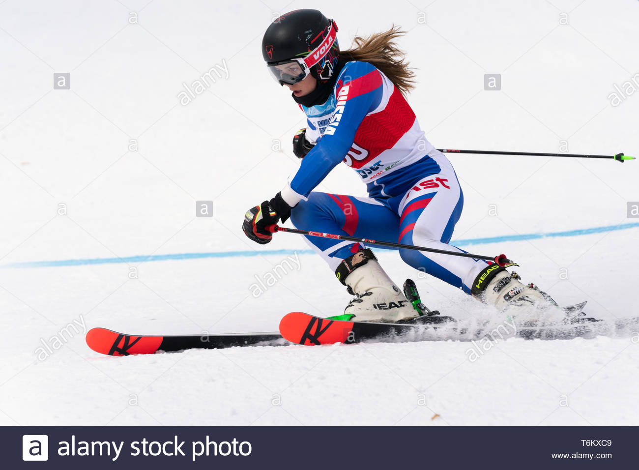 KAMCHATKA, RUSSIA - APR 2, 2019: Russian Women's Alpine Skiing Cup, International Ski Federation Championship, giant slalom. Mountain skier Ulyana Len - Stock Image