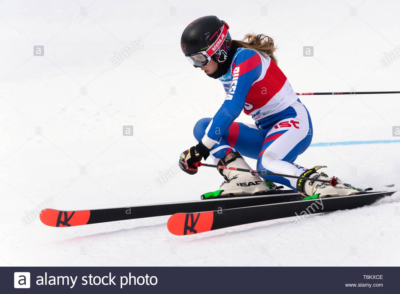 KAMCHATKA, RUSSIA - APRIL 2, 2019: Mountain skier Ulyana Lendya (Kamchatka Peninsula) skiing down mount slope. International Ski Federation Championsh - Stock Image