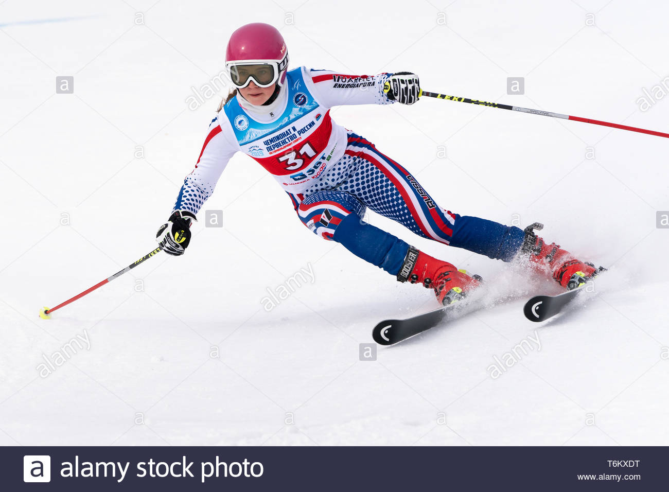 KAMCHATKA PENINSULA, RUSSIA - APR 2, 2019: Mountain skier Kryukova Darya (Chelyabinsk) skiing down mount slope. Russian Women's Alpine Skiing Cup Inte - Stock Image