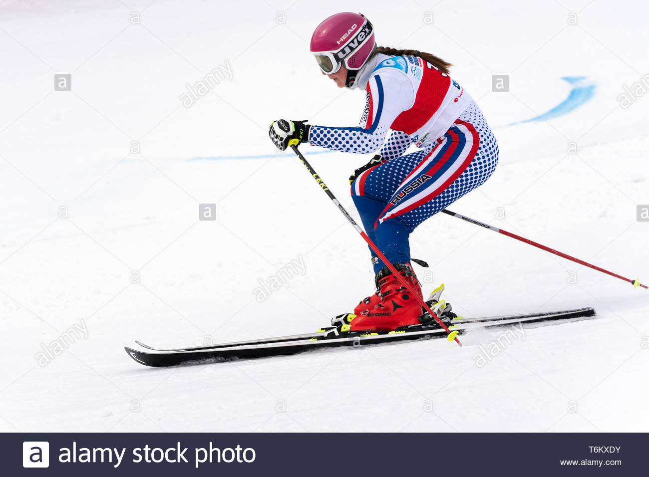 KAMCHATKA PENINSULA, RUSSIA - APR 2, 2019: Mountain skier Darya Kryukova (Chelyabinsk) skiing down mount slope. International Ski Federation Champions - Stock Image