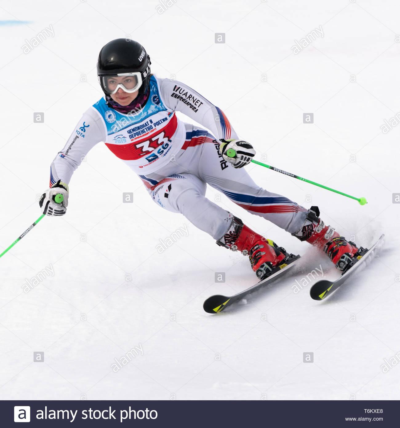 KAMCHATKA PENINSULA, RUSSIA - APR 2, 2019: Mountain skier Delhman Lidiya (Krasnoyarsk) skiing down mount slope. Russian Women's Alpine Skiing Cup Inte - Stock Image