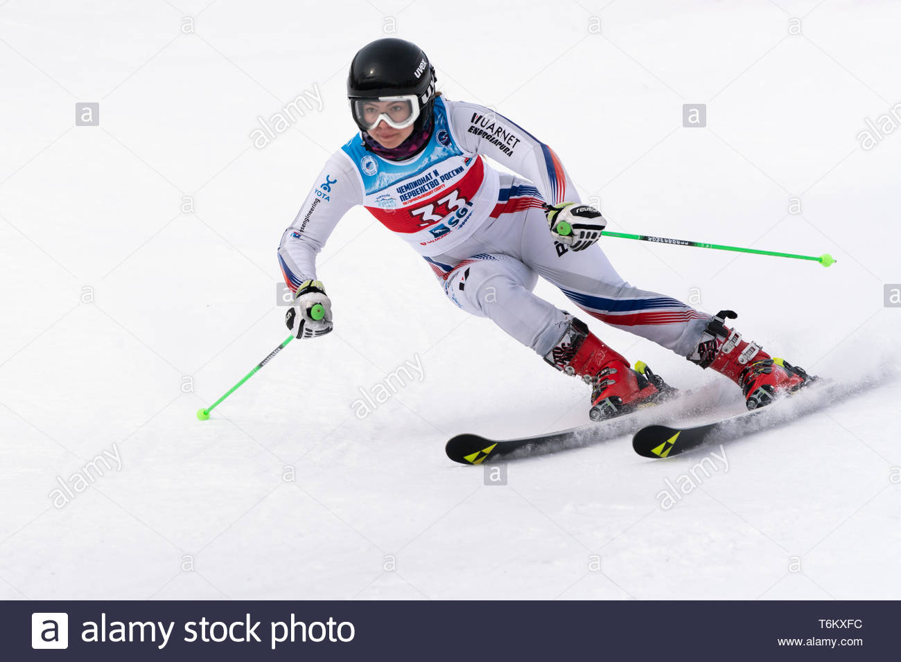 KAMCHATKA PENINSULA, RUSSIA - APR 2, 2019: Mountain skier Delhman Lidiya (Krasnoyarsk) skiing down mount slope. International Ski Federation Champions - Stock Image
