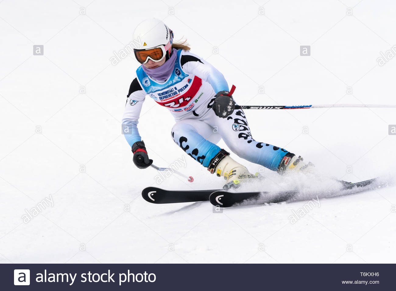 KAMCHATKA PENINSULA, RUSSIA - APR 2, 2019: Mountain skier Kazakova Vitalia (Murmansk) skiing down mount slope. Russian Women's Alpine Skiing Cup Inter - Stock Image
