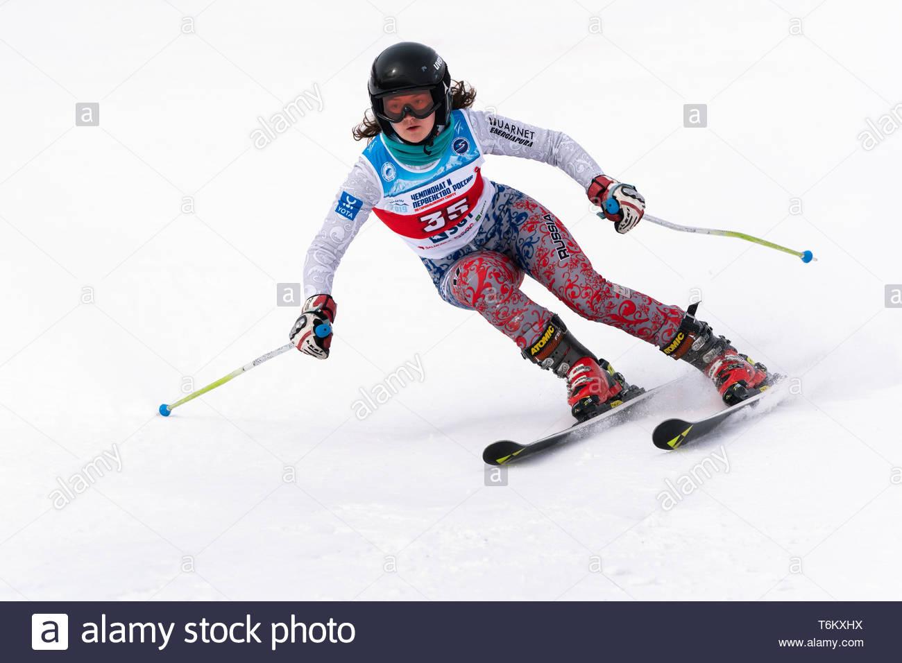 KAMCHATKA PENINSULA, RUSSIA - APR 2, 2019: Mountain skier Polina Delkhman (Krasnoyarsk) skiing down mount. Russian Women's Alpine Skiing Cup, Internat - Stock Image