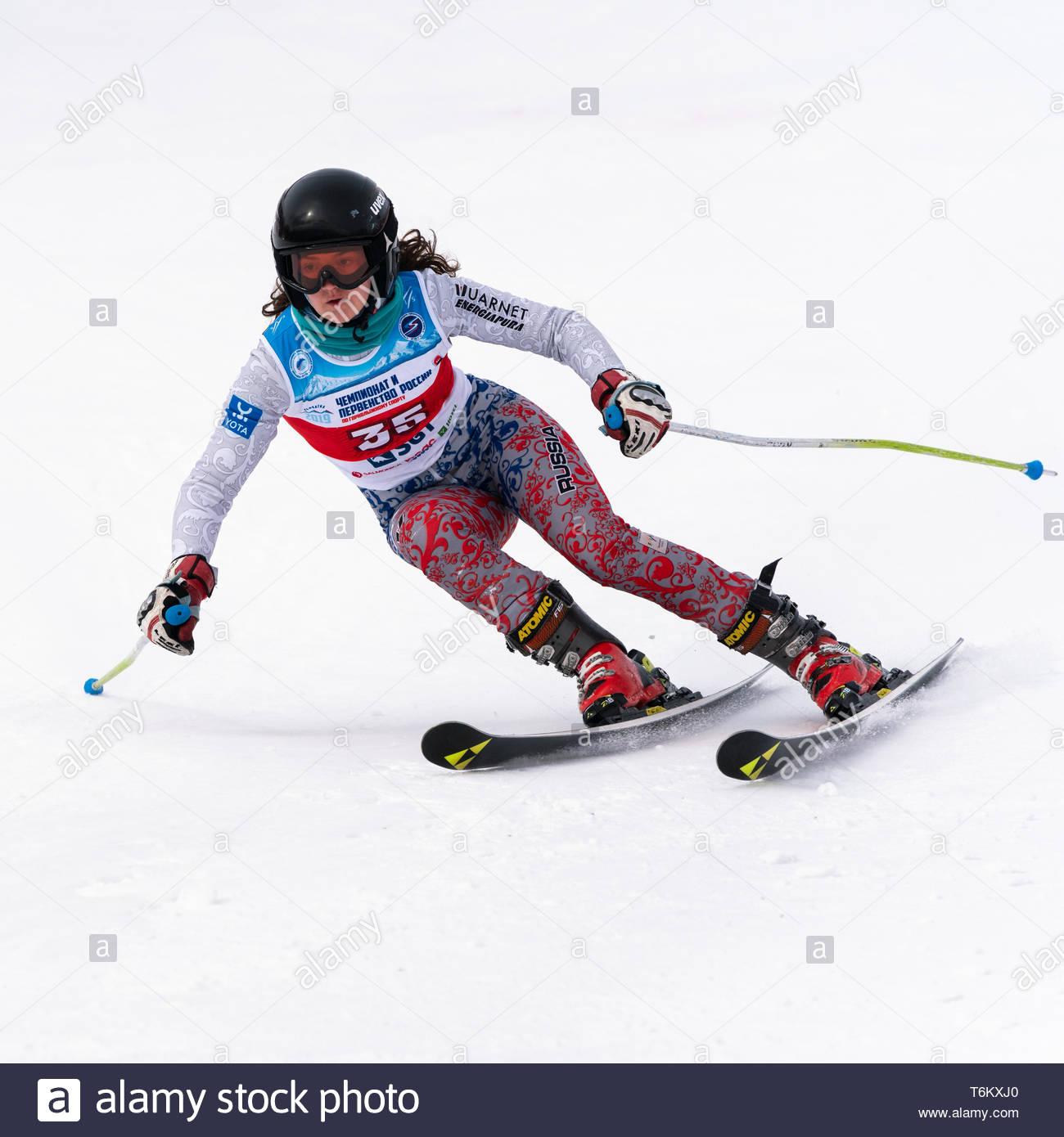 KAMCHATKA PENINSULA, RUSSIA - APR 2, 2019: Mountain skier Delkhman Polina (Krasnoyarsk) skiing down mount. International Ski Federation Championship,  - Stock Image