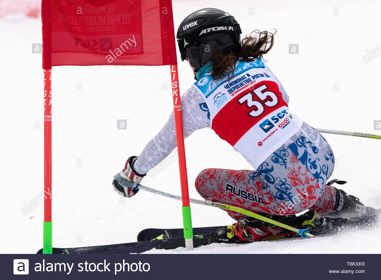 KAMCHATKA PENINSULA, RUSSIA - APR 2, 2019: International Ski Federation Championship, Russian Women's Alpine Skiing Cup, giant slalom. Mountain skier  - Stock Image