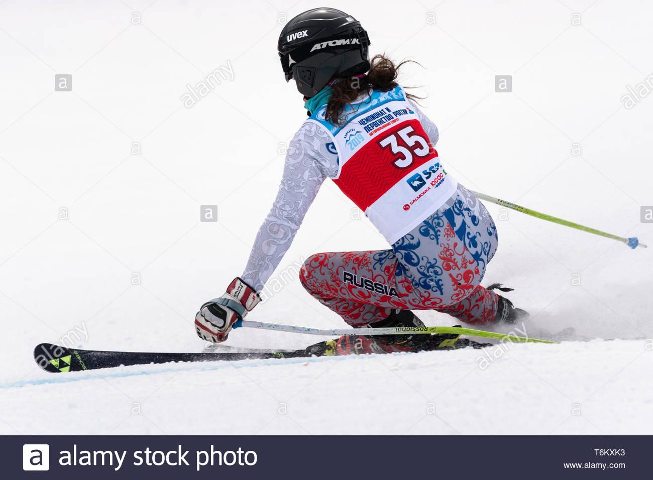 KAMCHATKA PENINSULA, RUSSIA - APR 2, 2019: Mountain skier Delkhman Polina (Krasnoyarsk) skiing down mount. Russian Women's Alpine Skiing Cup, Internat - Stock Image