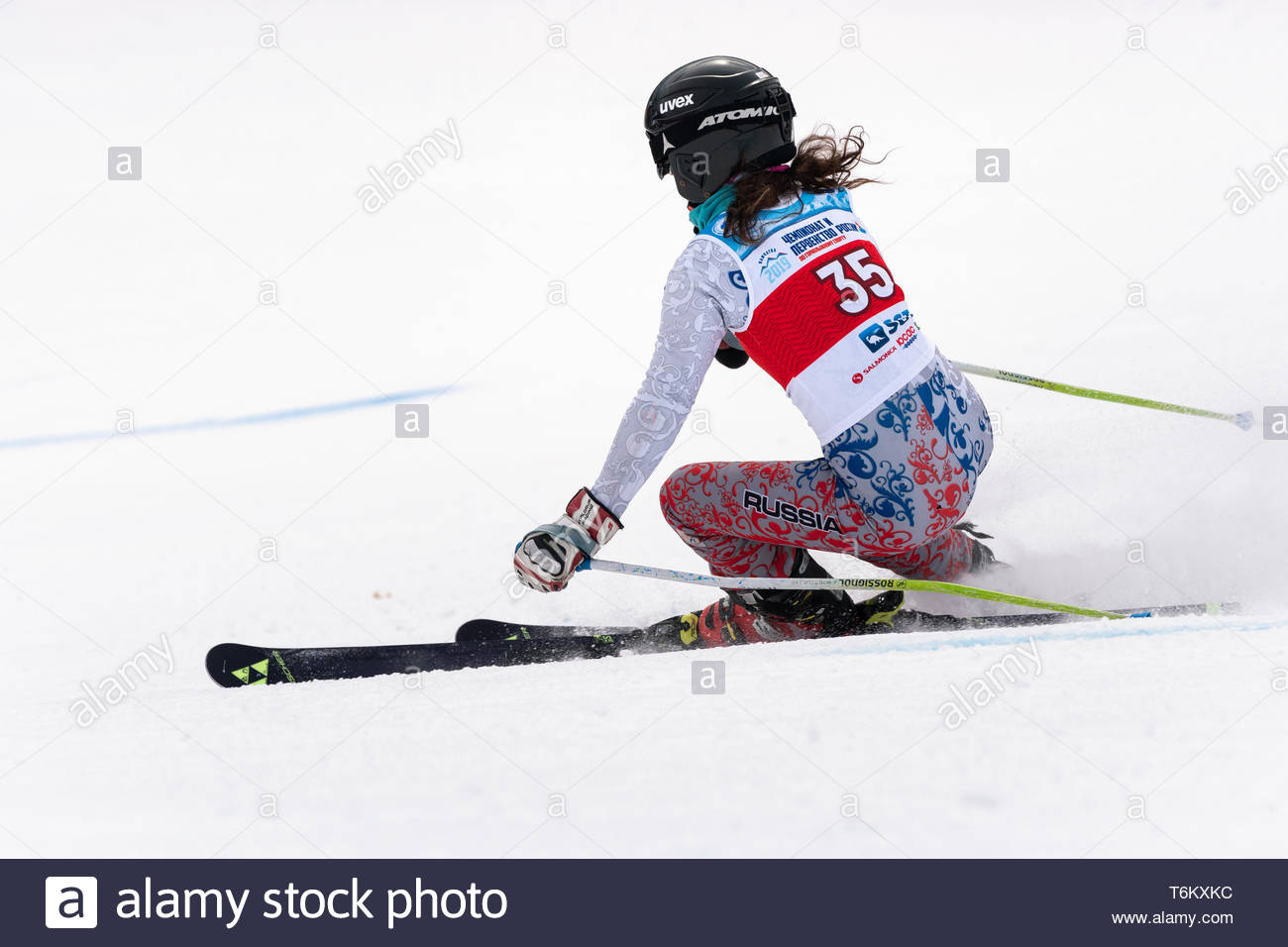 KAMCHATKA PENINSULA, RUSSIA - APR 2, 2019: Mountain skier Polina Delkhman (Krasnoyarsk) skiing down mount. International Ski Federation Championship,  - Stock Image