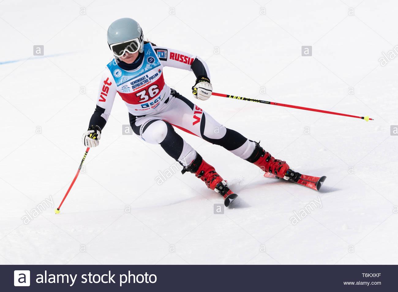 KAMCHATKA PENINSULA, RUSSIA - APRIL 2, 2019: Mountain skier Bochina Mariya (Moscow Region) skiing down mount. Russian Women's Alpine Skiing Cup, Inter - Stock Image