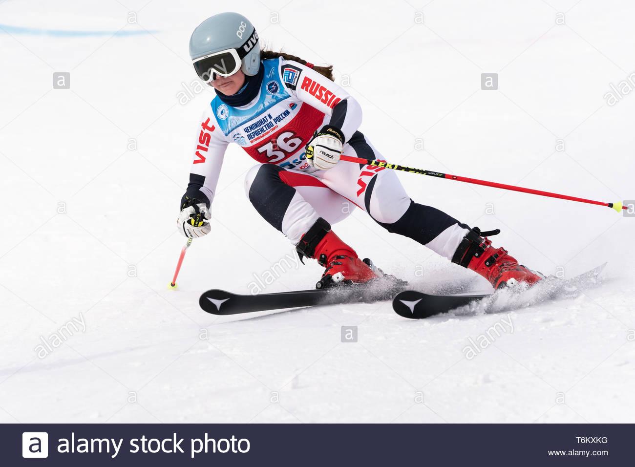 KAMCHATKA PENINSULA, RUSSIA - APRIL 2, 2019: Mountain skier Mariya Bochina (Moscow Region) skiing down mount. International Ski Federation Championshi - Stock Image