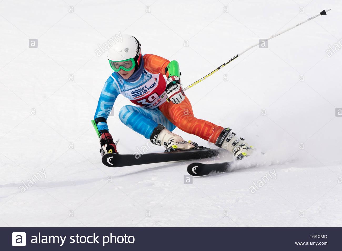 KAMCHATKA PENINSULA, RUSSIA - APR 2, 2019: Mountain skier Fugleva Victoria (Sakhalin) skiing down mount slope. Russian Women's Alpine Skiing Cup, Inte - Stock Image