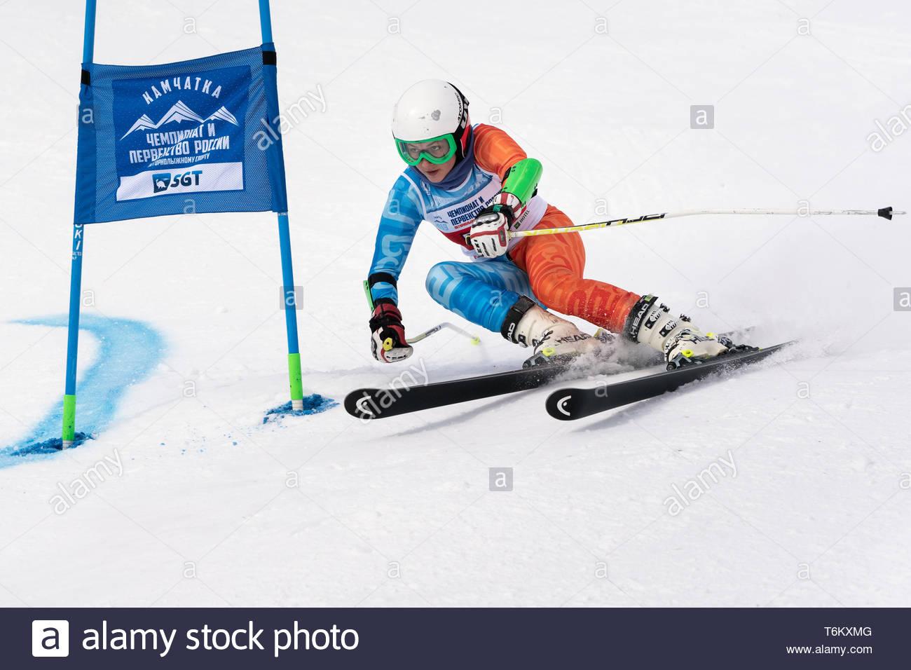 KAMCHATKA PENINSULA, RUSSIA - APR 2, 2019: Mountain skier Fugleva Victoria (Sakhalin) skiing down mount slope. International Ski Federation Championsh - Stock Image