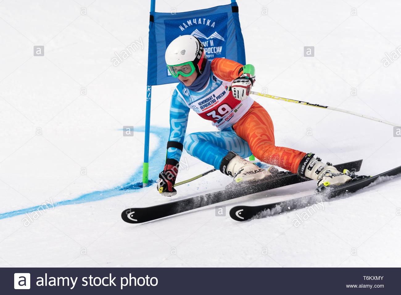KAMCHATKA PENINSULA, RUSSIA - APR 2, 2019: Russian Women's Alpine Skiing Cup, International Ski Federation Championship giant slalom slope. Mountain s - Stock Image