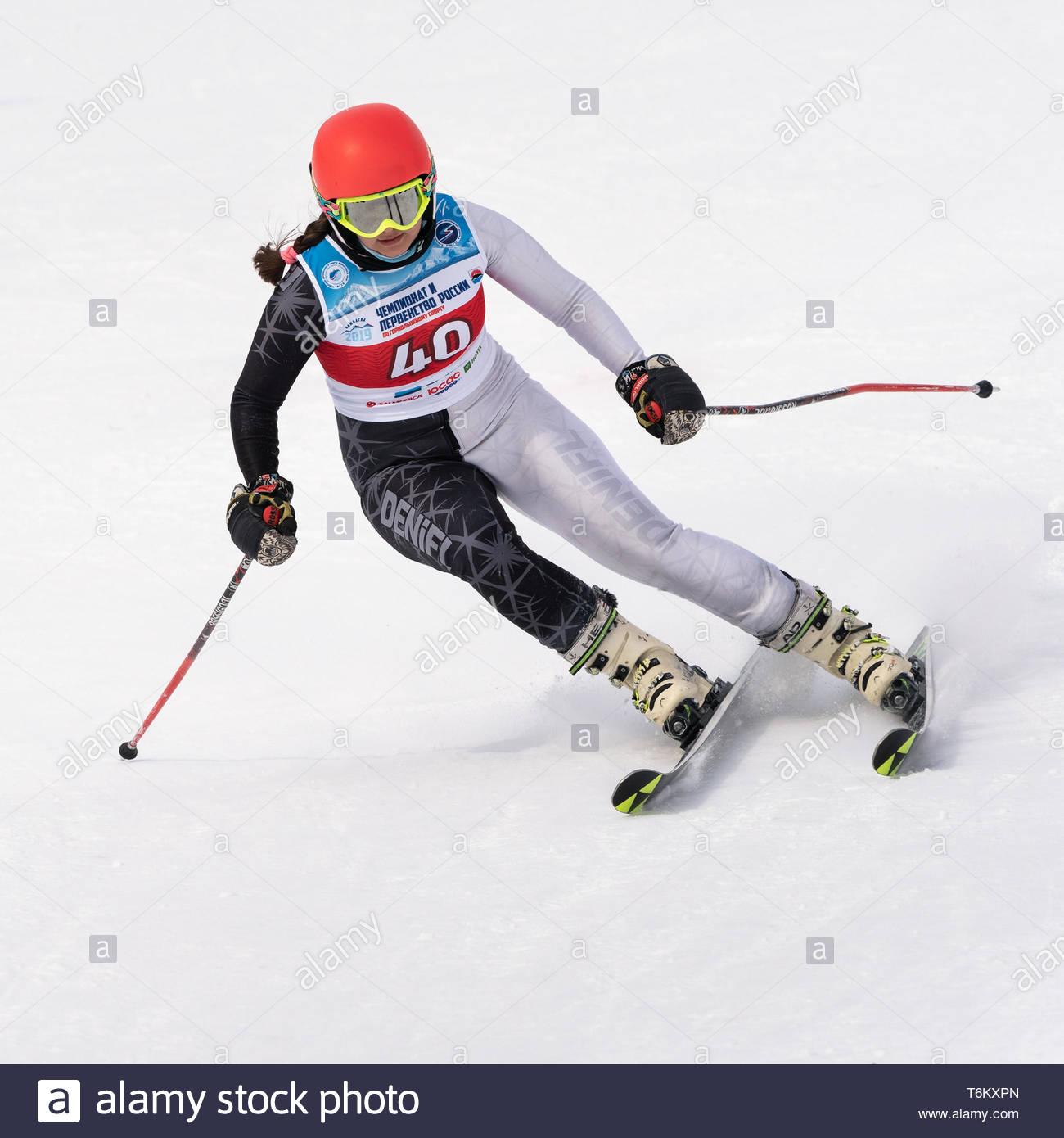 KAMCHATKA, RUSSIA - APRIL 2, 2019: Mountain skier Kudryavtseva Ekaterina (St. Petersburg) skiing down mount. Russian Women's Alpine Skiing Cup, Intern - Stock Image