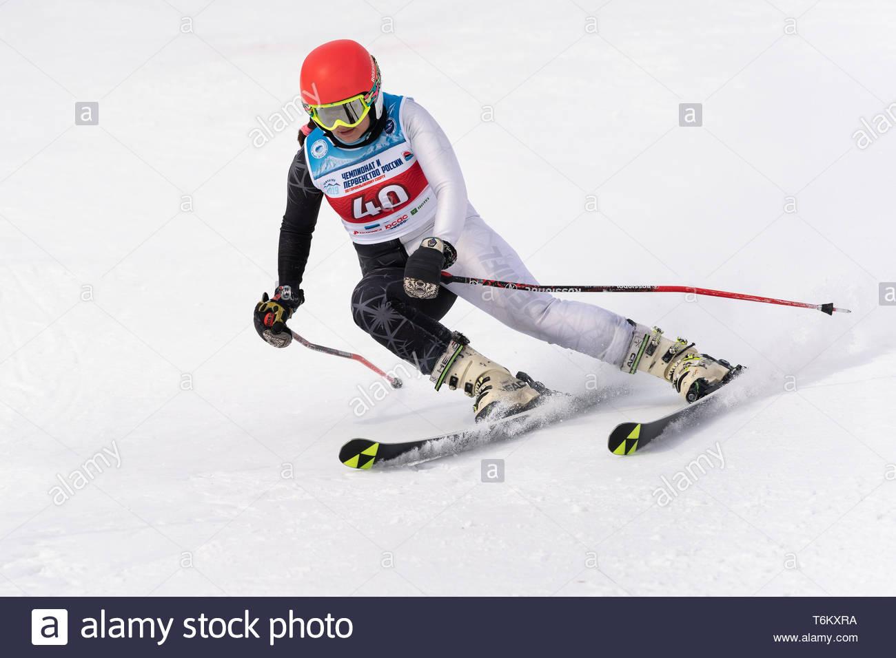 KAMCHATKA, RUSSIA - APRIL 2, 2019: Mountain skier Kudryavtseva Ekaterina (St. Petersburg) skiing down mount. International Ski Federation Championship - Stock Image