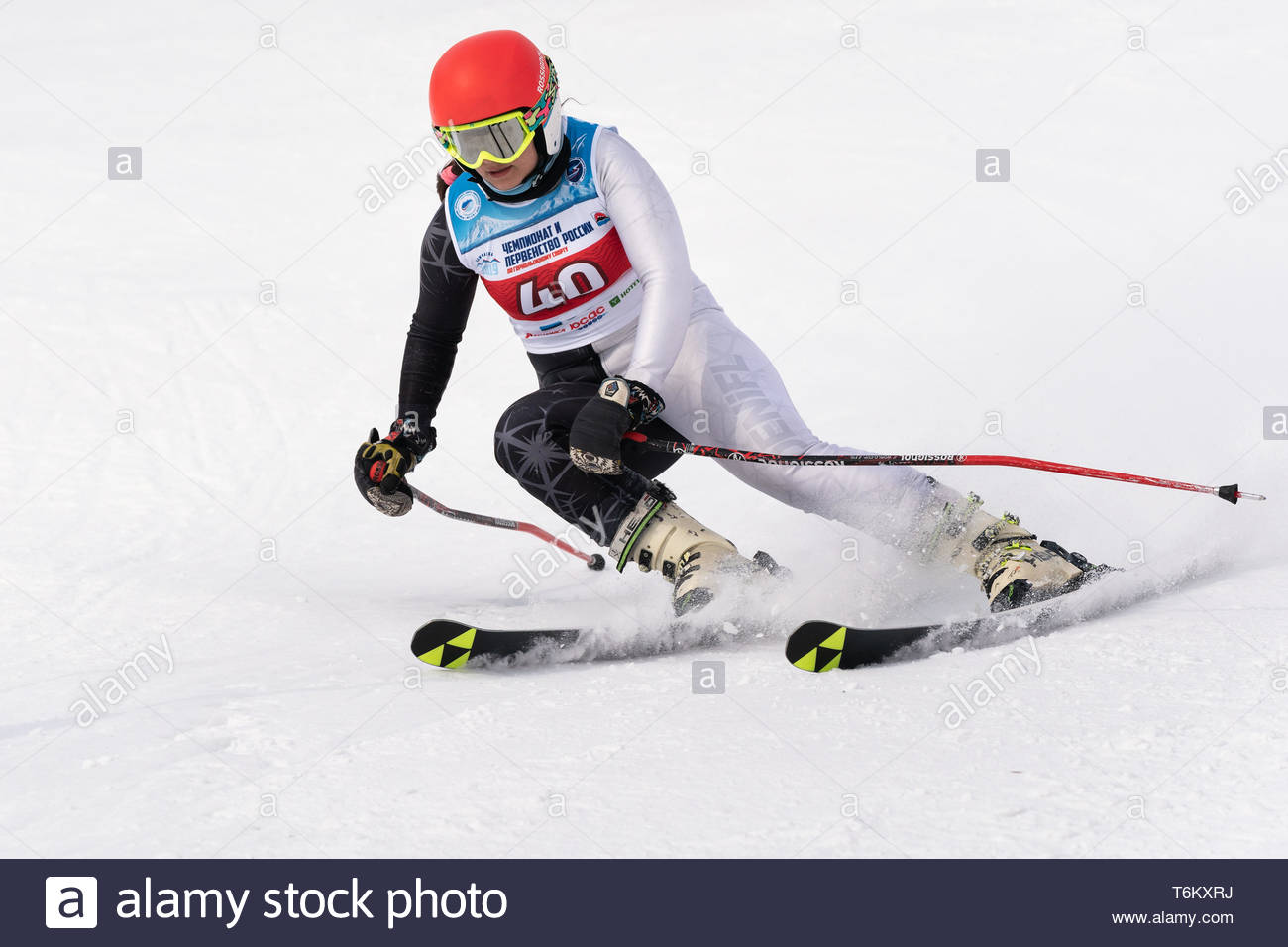KAMCHATKA, RUSSIA - APRIL 2, 2019: Russian Women's Alpine Skiing Cup, International Ski Federation Championship - giant slalom. Mountain skier Kudryav - Stock Image