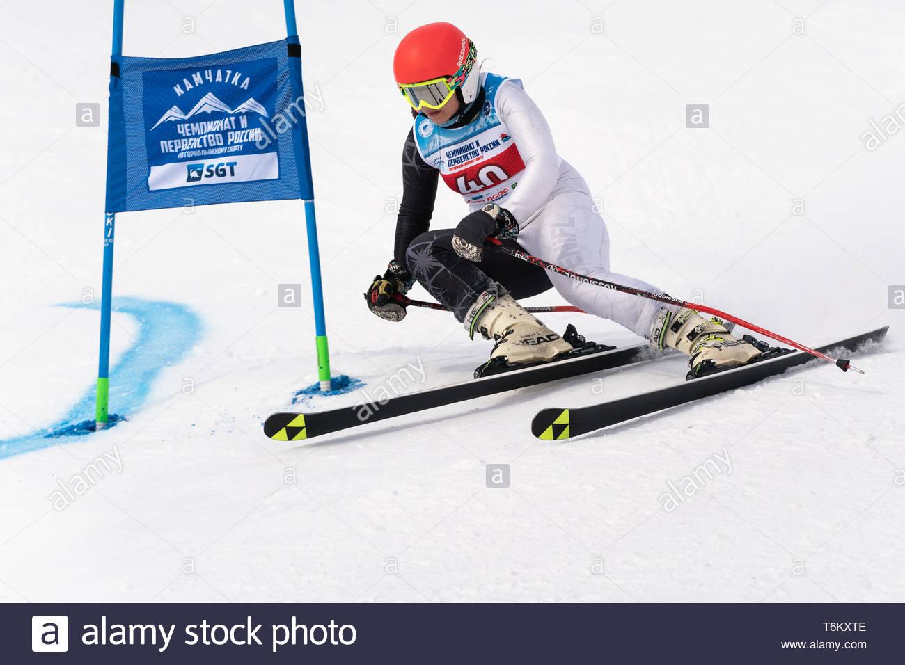 KAMCHATKA, RUSSIA - APRIL 2, 2019: International Ski Federation Championship, Russian Women's Alpine Skiing Cup, giant slalom. Mountain skier Kudryavt - Stock Image