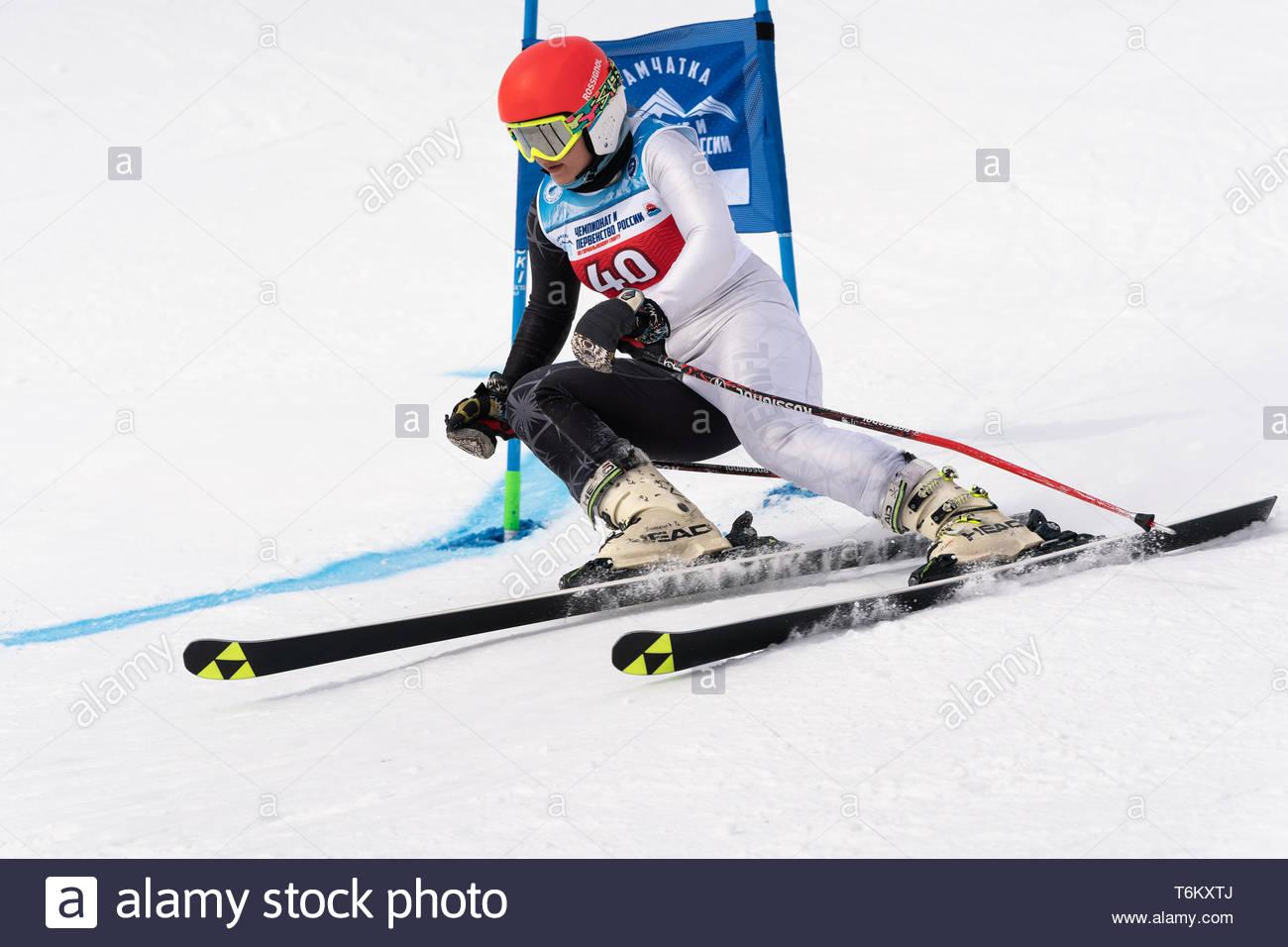 KAMCHATKA, RUSSIA - APRIL 2, 2019: Mountain skier Ekaterina Kudryavtseva (St. Petersburg) skiing down mount. Russian Women's Alpine Skiing Cup, Intern - Stock Image