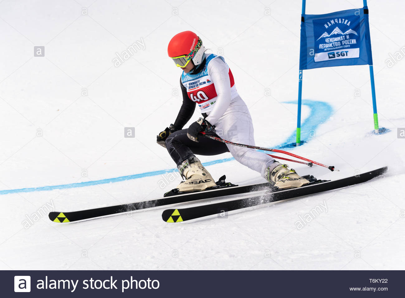 KAMCHATKA, RUSSIA - APRIL 2, 2019: Russian Women's Alpine Skiing Cup, International Ski Federation Championship - giant slalom. Mountain skier Ekateri - Stock Image